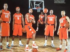 Syracuse Basketball Team Members - 2011-2012    Kris Joseph, C.J. Fair, Scoop Jardine, Rakeem Christmas, Brandon Triche & Fab Melo about to dunk in the background.