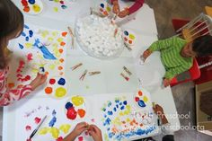 Cotton Ball Painting and building fine motor skills by Teach Preschool