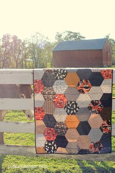 Large Hexagon Quilt Tutorial -- uses rows of half-hexagons