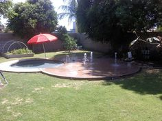 Backyard splash pad (use the slab as a patio when needed); great for kids, teens, and adults. DIY or contract out?