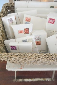 Simple newsprint, twine and vintage stamps (bet I could find some at Graphics Fairy). She found hers at Anthropology.