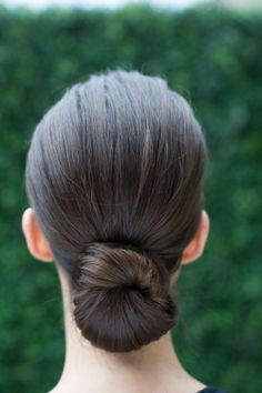 a perfectly polished chignon for #Spring2015 is the ultimate timeless look #CarolinaHerrera