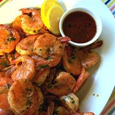 A blend of olive and sesame oil, hot sauce and chile sauce make this is an amazing spicy grilled shrimp recipe.