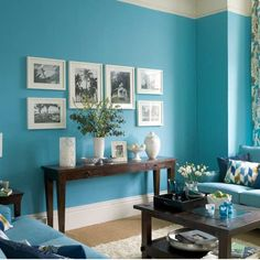 Love this wall color.  I also love the arrangement of the framed photos.