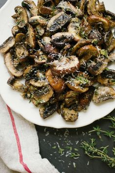 Baked Lemon and Thyme Mushrooms. I left out the lemon/lemon juice. Still good! Served it over my skillet steak from the other night mixed with some okra.