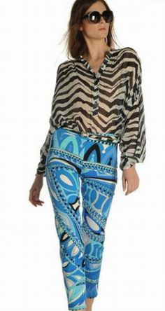 Emilio Pucci Silk Geometric Knitted Pant is a good choice for summer days for its cool material. Match the Emilio Pucci Dress Pants with a pair of light blue high heels is quite a good choice. You will really win high rate of second glance.