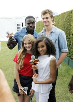 THE HUNGER GAMES stars stop by the EXTRA Stage at Comic-Con 2012; clockwise from top left: Dayo Okeniyi, Jack Quaid, Amandla Stenberg and Willow Shields (© WBEI. All Rights Reserved.)