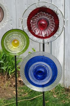 old plates, cups, saucers repurposed into garden flowers