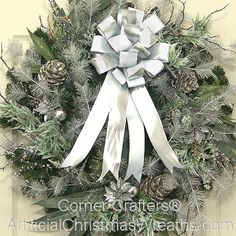 Winter Wreath - 2013 - Our beautiful Winter Wreath is a wintry medley of snow tipped evergreens, pine cones, berries, icicles and is finished with a lovely bow. - #WinterWreaths #ChristmasWreaths #ArtificialChristmasWreaths #Wreaths #Wreath