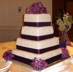 Wedding Cake, Purple -I LOVE the look of this cake and the shade of purple would be great as an accent to a wedding dress and the theme color of the wedding....