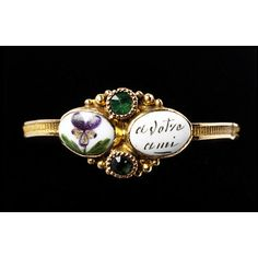 This ring was a romantic present from a man to his love. The French word 'pensées' means both pansies, as painted on the bezel of this ring, and 'thoughts'. In this case the pansies stand for 'pensez', meaning 'think'. The flowers and words taken together read 'Pensez à votre ami', 'think of your friend'. The lover hoped that his love would wear the ring and think of him.    France, 1818-1838