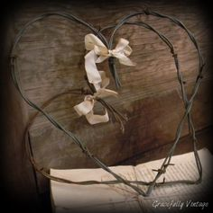 Valentine Barbed Wire Heart. I Love the rustic appeal of these.