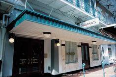 Galatoire's has stood at 209 Bourbon Street for more than 100 years. galatoires-by-louis-sahuc