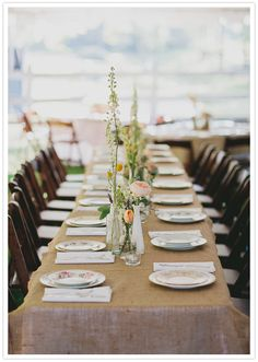burlap-covered dining tables/vintage plates