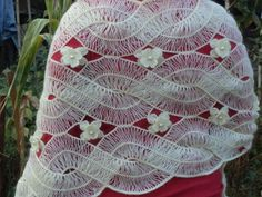 Hairpin lace braided in strips and joined with floral motifs. Gorgeous!
