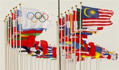 Flags fly in the strong breeze at the Olympic sailing venue in Portland today. (© PA Wire Press Association Images)
