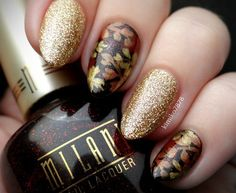 The combination of the luxe gold glitter and the rich leaves in this manicure is so enticing. It's fall-appropriate without being too understated, perfect for the gal who loves to rock glitter year-round! See more of Kim's beautiful nail art on her Instagram @kimiko7878.