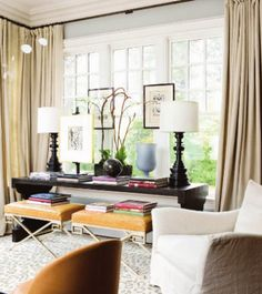 console in the window with ottoman stools | furniture layout... Nix the art on window.