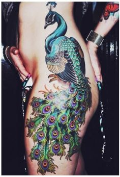 Gorgeous colorful peacock tattoo  http://blog.tattoodo.com/2014/04/40-enticing-peacock-tattoos/