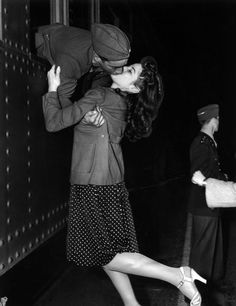 """Soldier Leaving for War"" (1941). From the window of the train, Private Joe Sunseri grabs a last minute kiss on March 11, 19141, from his girl, Alma Teresi."