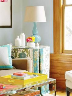 Living Room Makeover - Better Homes and Gardens - BHG.com ~ tailored skirt for an end table out of a colorful tablecloth.