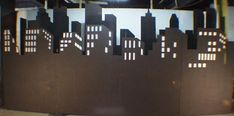This black skyline is a perfect for my city theme event. Lights show through windows.