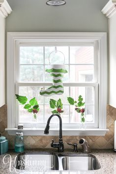 Spray paint an outdated metal Christmas stocking with a fun chevron pattern using Frogtape Shapetape for a fresh, fun Christmas kitchen window.