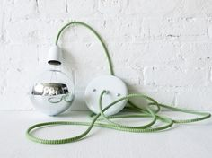 Green and White Pendant Light Cord w/ Large Silver Globe Bulb $70