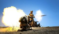 Marines engage a target with an AT-4 light anti-armor weapon on Range 800.