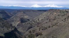 View of Sisters via Deschutes River Canyon in Crooked River Ranch, Oregon