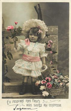 adorable Victorian girl with flowers