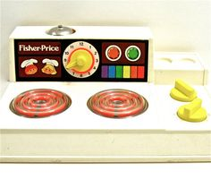 Vintage Fisher Price Stove Top. Totally remember this from when I was a kid.