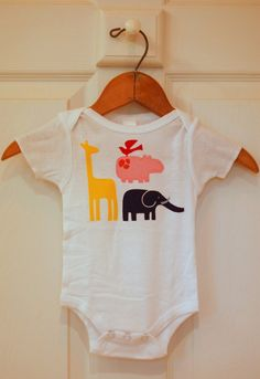 onesie with animal cutouts from our nursery fabric appliqued on it!
