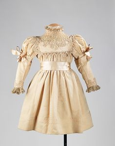 Girl's Dress, 1895.  Bon Marché   This charming girl's party dress was purchased in Paris by General and Mrs. John B. Woodward in 1895 and given to Elizabeth Haynes. Produced by the prestigious department store Au Bon Marché, it is an example of high end children's ready-to wear produced by the department store. Of added interest, is the observance of the fashion for full sleeves of the period for the young wearer. dress 1895, party dresses, 1890, metropolitan museum