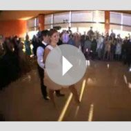 A retro-inspired first dance is a great way to add a some flair to your wedding reception. This couple surprised their guests with an amazingly-coordinated swing dance, and the reaction is priceless!