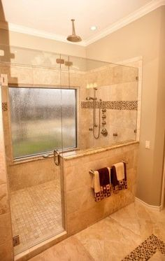 Another good configuration for the shower door front.  Frameless shower with window... Would need an amazing piece of property to pull off the giant window, but I like it!