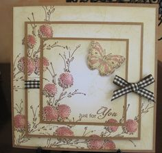 """By Michele. Stamp """"Delicate Florals"""" (Penny Black), colored with brown & pink markers, 3 or 4 times on white cardstock square. Sponge from edges toward center with tan ink. Leave white """"glow"""" in center. Die cut medium square from center of piece. Then die cut smaller square from center of medium square. Stamp sentiment on this square.Mat each square on kraft cardstock. Add ribbon & bow to medium square piece. Assemble. Add butterfly."""