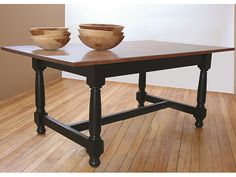 "Reproduction Tavern Table features a 1"" thick natural Cherry wood top with maple base finished in durable black lacquer. Traditional ""William & Mary"" style turned legs."