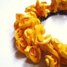 Melted lego necklace- so freakin awesome!!!!!!!!!!