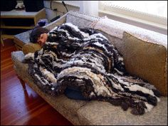How to Make a Rabbit Skin Blanket...could Isaiah get to work on this