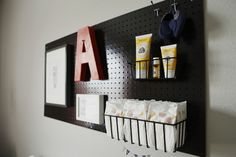 Pegboard over the changing table to hold supplies + display decor = genius! #nursery