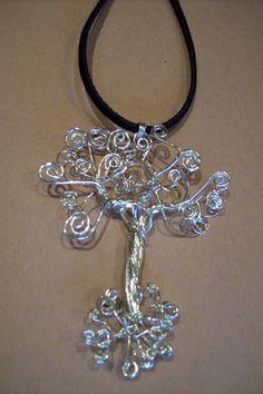 Tree of life pendant has no frame around it.