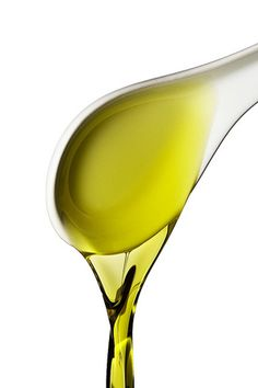 """Olive oil isn't just for cooking — it's great for your hair, too! Olive oil has been proven to give hair a healthy sheen, help to repair split ends, and reduce frizz.    To give your hair a conditioning treatment, massage about 2 tablespoons of olive oil into your hair and scalp. The amount you'll use should vary depending on the length and thickness of your hair. And remember to massage it in well – the massaging feels really nice on your scalp, but is also important to the treatment, as massage stimulates helps promote a healthy scalp.    Next, take a warm, damp towel and wrap it around your head and treated hair (""""turban"""" it). Leave it on for about 30-45 minutes. This allows the olive oil to work into your hair to have the full effect.    Finally, rinse out the olive oil with shampoo. This might take a few shampoo-ings (when I tried it, it took 2 rounds.) Give your hair further rest by allowing it to air dry, if you have the time. Then say hello to your luscious locks!"""