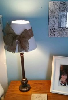 Lamp redo.....painted the shade white and made the burlap bow!!