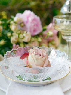 """The scalloped edging and design on the FRODIG glass bowl looks like lace and was inspired by bridal gowns.  Mix and match with patterned plates for a table setting that's """"clearly"""" romantic."""