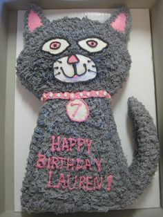 a very do-able cat cake. She has a little bit of a description on how she did it. She used a round cake pan and a rectangular one.