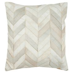 Add a pop of pattern to your favorite arm chair or guest room daybed with this distinctive cowhide pillow, showcasing a chevron-inspired motif in white.