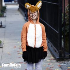 Fantastic Fox: Our costume's no-sew tail gets its shape from a hidden wire hanger. Complete the foxy finery with black gloves and boots.