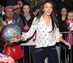 Michelle Keegan in a white bird print shirt with studded collar and zip pocket pants as she leaves Coronation Street studios after filming final scenes as doomed Tina McIntyre