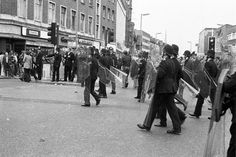 """""""Police in Lewisham town centre, where clashes continued at the end of the march. This was the first time police had used riot shields in Britain."""" Transpontine: Lewisham '77 photos by Chris Schwarz"""